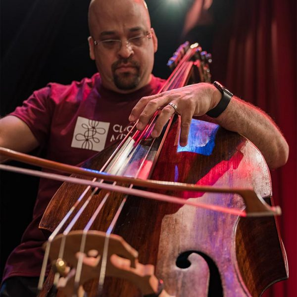 George Amorim playing bass